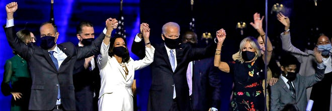 From left, Douglas Emhoff, Vice-President-elect Kamala Harris, President-elect Joe Biden and Dr. Jill Biden celebrate with supporters after declaring victory in the presidential election at the Chase Center in Wilmington, Delaware, on Saturday, Nov. 7, 2020. (Carolyn Cole/Los Angeles Times/TNS)
