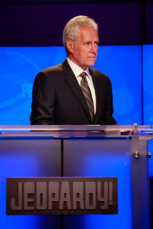 "Alex Trebek rehearses for a January 2011 episode of ""Jeopardy!"" featuring a trivia showdown against an IBM computer in Yorktown Heights, New York. Trebek died Sunday, Nov. 8, 2020; he was 80."
