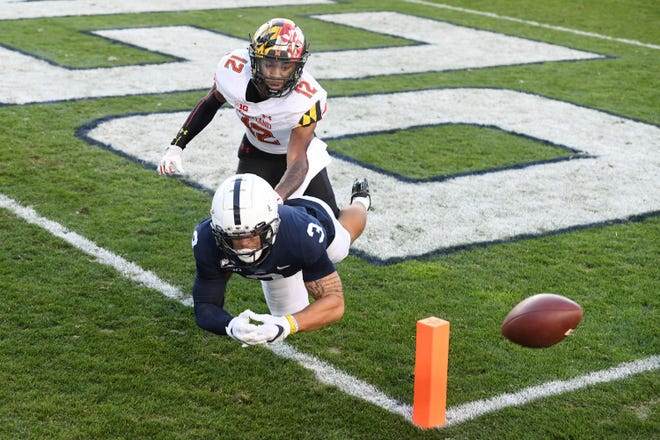 Maryland defensive back Tarheeb Still (12) battles Penn State wide receiver Parker Washington (3) for an incomplete pass in the first quarter of an NCAA college football game in State College, Pa., Saturday, Nov. 7, 2020. (AP Photo/Barry Reeger)