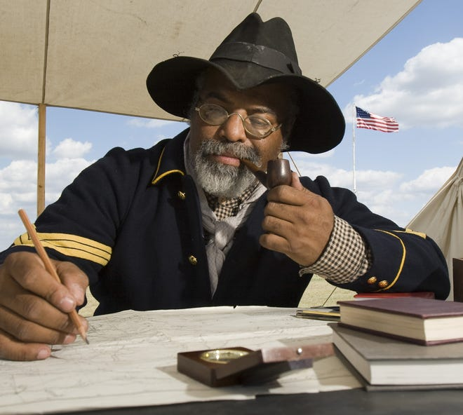 Albany - In this file photo, Henry Crawford reenacts the duties of a Buffalo Soldier sergeant. Fort Griffin, one of several frontier outposts defending Texas settlers against hostile Indians and outlaws, 1867-1881; served by Buffalo Soldiers of the Ninth Cavalry.