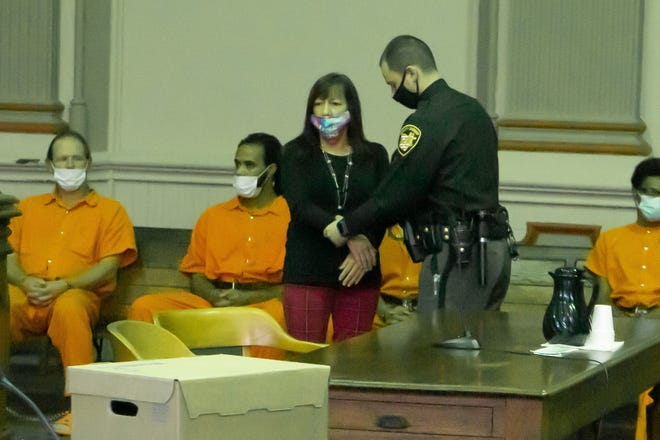 Deborah Kirsch is handcuffed and placed next to the other inmates to begin serving her six-month jail sentence.