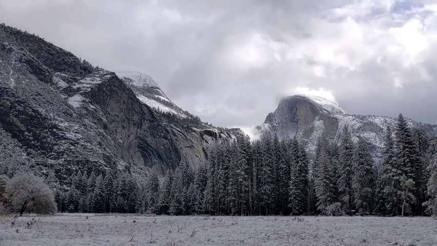 Snow blankets Yosemite valley as authorities warn of winter storm conditions