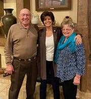This Tuesday, Nov. 3, 2020, photo provided by Yvette Herrell's campaign shows the Republican candidate, center, with her parents, Tommy and Josette Herrell, following her victory in the 2nd Congressional District after the family watched Election Night returns at their home in Alamogordo, N.M. Herrell is among New Mexico's first all-female U.S. House delegation. Herrell defeated incumbent U.S. Rep. Xochitl Torres Small. (Herrell Campaign via AP)