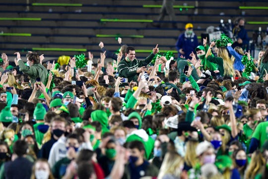 Students and fans storm the field after Notre Dame's 47-40, double-overtime victory over Clemson.