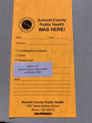 This is a door hangar that the Summit County Public Health Department will hang on the doors of residents they are trying to reach if they cannot reach them by phone after a COVID-19 positive test.