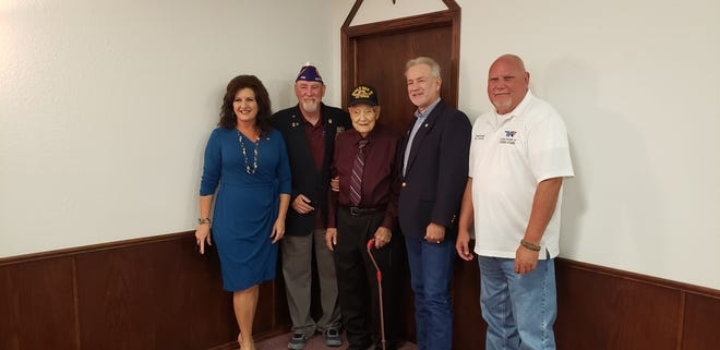 World War II veteran Joe Bartlett received a Purple Heart on Monday, over 75 years after being injured by Japanese kamikaze pilots in June 1945. From left to right: Rep. Tammy Townley R-Ardmore, State Commander of the Military Order of the Purple Heart Larry Van Schuyver , Joe Bartlett, Rep. Tommy Hardin R-Madill, Commissioner Mike Jackson.