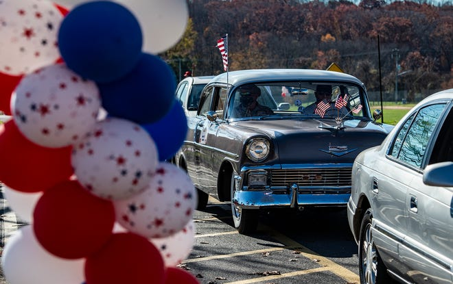 Veterans participate in the 20th anniversary Veterans Day ceremony at the Maple Point Middle School in Middletown on Tuesday, Nov. 10, 2020. Due to COVID-19, the ceremony was transformed into a drive-by parade.