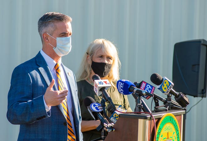 Bucks County Commissioners Bob Harvie, left and Diane Ellis-Marseglia, speak about the upswing in COVID-19 cases in Bucks County during a news conference Tuesday, November 10, 2020, at the county's General Services Warehouse in Warrington.