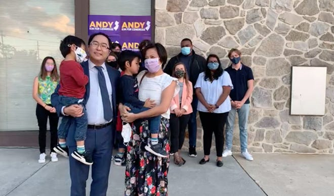 Andy Kim with his family following his victory speech outside of his Willingboro campaign office on Tuesday, Nov. 10.