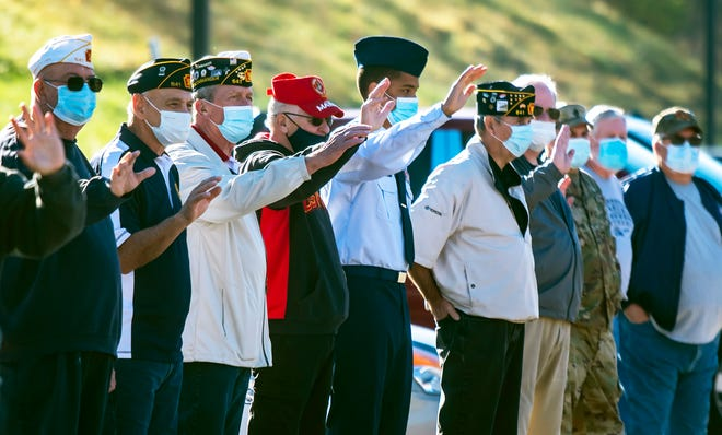 Local veterans wave to students and staff at State Street Elementary School in Baden who organized a parade in their honor Tuesday morning in the school courtyard.