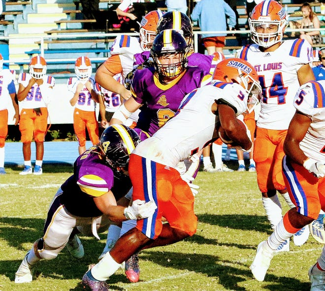South Beauregard defender Cale Jacobsen (4) wraps up on a tackle during the Golden Knights win over St. Louis on Saturday.