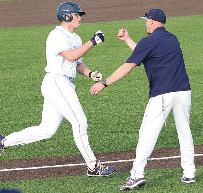 Braeden Winters, left, rounds third base and heads for the plate following a home run while Bartlesville High head baseball coach Cody Price congratulates him.