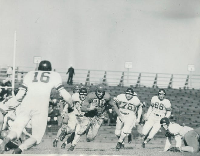 Ohio State's Paul Sarringhaus (88), shown in a 1942 game against Northwestern, was a key player for the Buckeyes down the stretch that season as injuries decimated OSU's corps of halfbacks.