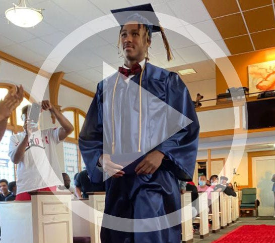 After announcing his plans to graduate high school early and enroll at Ohio State in December, Meechie Johnson Jr. was surprised with a graduation ceremony at Harvest Time Evangelistic Ministries Worship Center in Cleveland on Nov. 8, 2020.