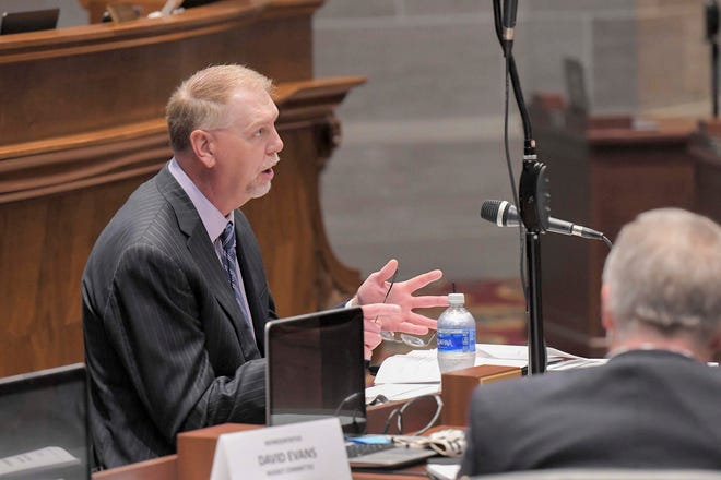 Dan Haug, Missouri Office of Administration Budget Director, presents information during today's House Budget Committee hearing.  The hearing was held in House Chamber to accommodate Covid-19 social distancing.