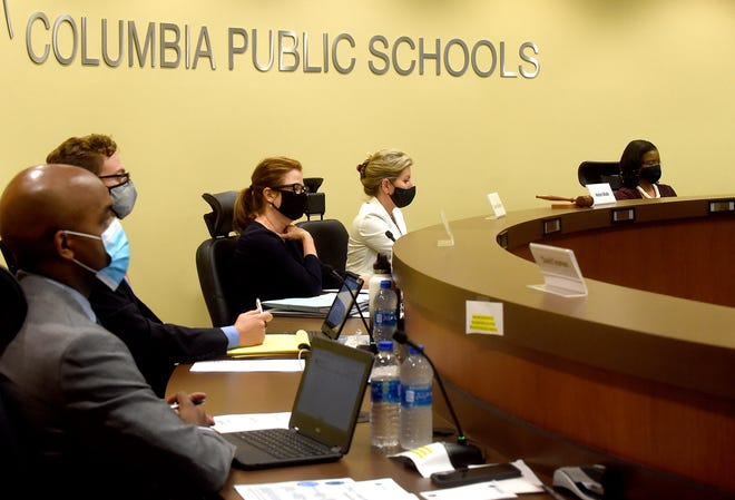 Columbia Public Schools board members listen to teachers and parents during a meeting Nov. 9.