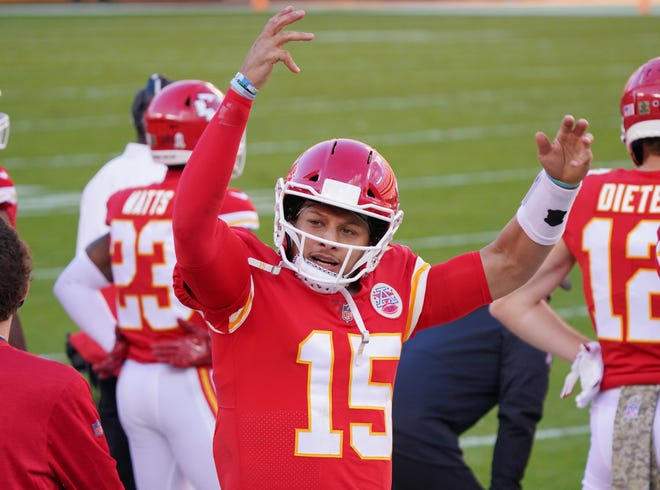 Kansas City Chiefs quarterback Patrick Mahomes (15) signals to fans on the sidelines during a game against the Carolina Panthers on Sunday at Arrowhead Stadium.