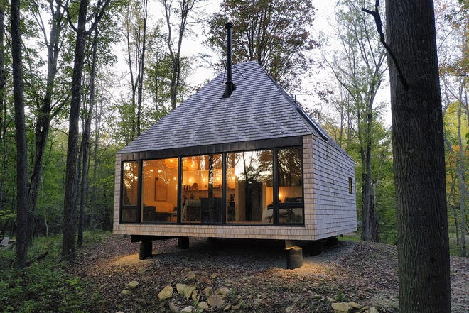 """The """"hut,"""" a 600-square-foot cabin near Flushing, Ohio, designed by the Midland architectural firm, received an honor award in the """"small project"""" category in the annual awards sponsored by the Columbus chapter of the American Institute of Architects."""