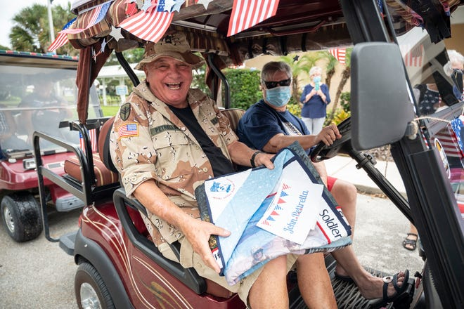 John Pettrella receives an honorary quilt for his time in the service at Sunlake Estates in Grand Island on Sunday. [Cindy Peterson/Correspondent]
