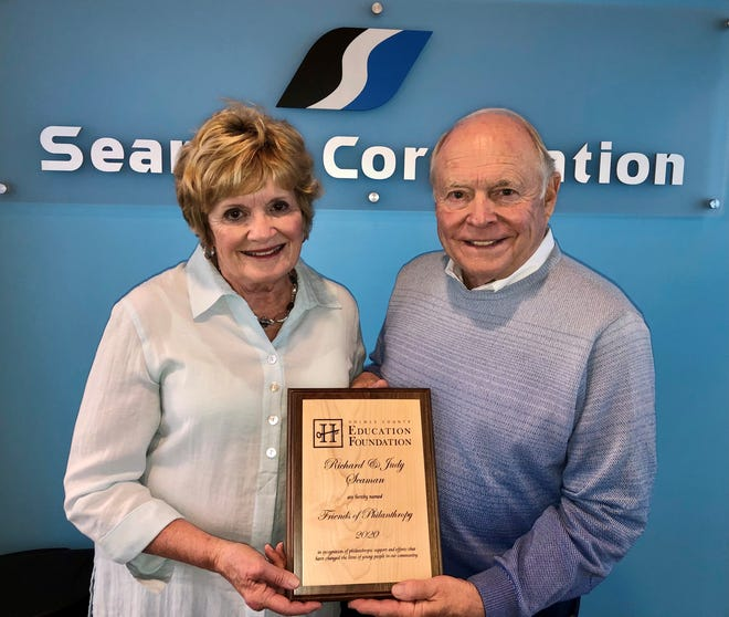 Richard and Judy Seaman display the Friends of Philanthropy award they received from the Holmes County Education Foundation.