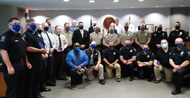 All law enforcement departments that operate in Davidson County were honor by the Lexington Area CrimeStopper during a county commissioners meeting on Tuesday.