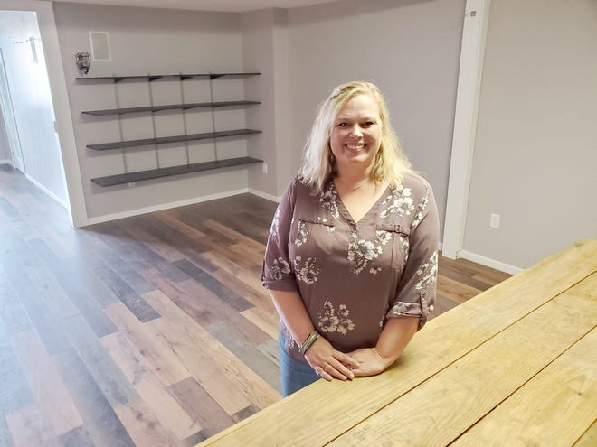 Ashley Snyder stands inside the new home of her business Table and Root. The business will have a roof and walls once it moves inside 15 Murphy Drive, Suite 3, in Lexington at the Center 64 West shopping center. She began Table and Root earlier this year as an outside produce market on the sidewalk and under a tent in the parking lot in front of Evenbrook Marketplace.