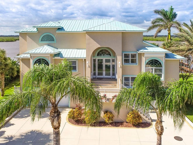Set in the quiet enclave of Wilbur by the Sea, this elegant three-story estate on the shores of the Intracoastal Waterway provides panoramic views of the river.