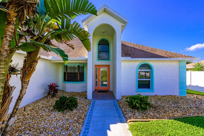 This pristine, move-in-ready beachside home on Sea Gull Drive has been lovingly maintained and has a two-car garage and a screened-in pool and spa out back.