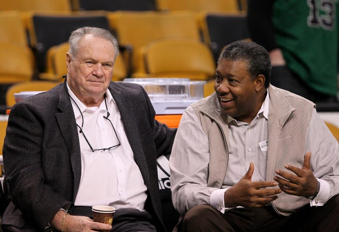 Boston Celtics commentator and former player Tommy Heinsohn (left) chats with James I. Cash (right) of the Celtic ownership group before the game against the Indiana Pacers at the TD Garden on Dec. 19, 2020.