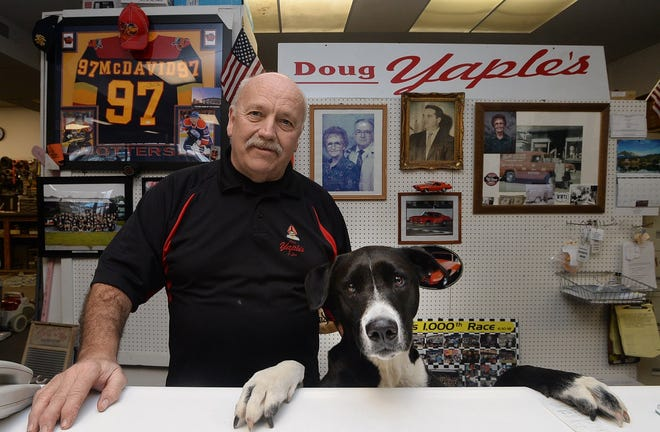 Doug Yaple, owner of Doug Yaple Vacuum Center at 1815 E. 38th St. in Erie, is shown with his dog Nikki Dee at the shop on March 10. Yaple has opened a second location at 2301 W. 12th St.