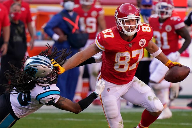Kansas City Chiefs tight end Travis Kelce (87) stiff-arms Carolina Panthers free safety Tre Boston (33) after making a catch in Sunday's game against Carolina. The Chiefs take an 8-1 record into the bye week.