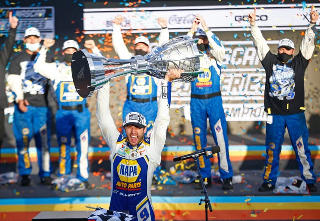 Chase Elliott celebrates winning the 2020 NASCAR Cup Series after winning the Season Finale 500 at Phoenix Raceway.