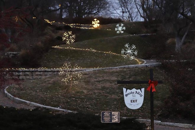 Snowflake decorations are shown in 2018 on Snake Alley in Burlington. There will be a group decorating the street for the holidays at 10 a.m. Saturday.