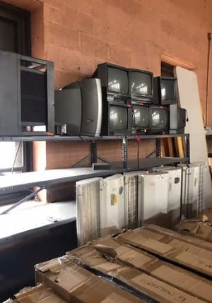Outdated computer monitors are some of the equipment that has accumulated as part of the town's surplus equipment and furniture that no longer work or has any use, all of which are gathering dust, packed onto the stage in the Grafton municipal center's gym.