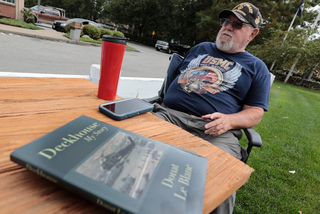 "Vietnam veteran Donat Le Blanc enjoy some morning coffee with fellow Vietnam veterans in Freetown.  Le Blanc just released a book entitled ""Deckhouse: My Story,"" which documents his ordeal as a helicopter gunman during the Vietnam war."