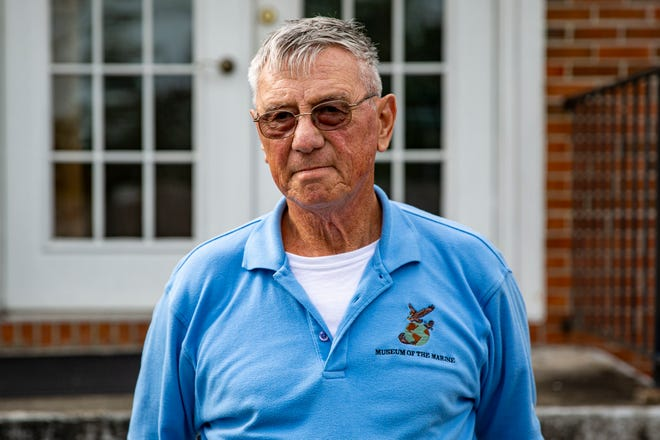 Joseph Houle, a retired U.S. Marine Corps sergeant major, poses for a photo at the WAVQ Radio Station in Jacksonville, North Carolina, Oct. 29.