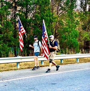 U.S. Marine Corps veteran Keith Bridges, right, and Jim Lafferty ruck through Northern Virginia en route to Arlington National Cemetery, Nov. 9.