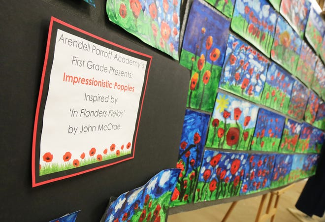 """Paintings of poppies based on John McCrae's poem """"In Flanders Fields"""" are on display at the G.I. Joe's Military Living History Museum, which were painted by 45 Arendell Parrott Academy first graders in art teacher Samantha Rouse's class for Veterans Day."""