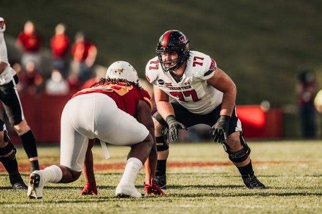 Newcomer Ethan Carde (77), viewed as a raw lineman with long-range potential when he signed last winter, has stepped in and started every game this season at left tackle for Texas Tech. Though Carde has had ups and downs at pass protection's most demanding position, the Red Raiders are third in the Big 12 in fewest sacks allowed.