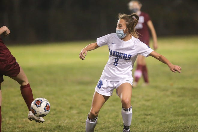 Dover-Sherborn senior Lily Thomson blocks the ball during a girls soccer game against Millis at Millis High School on Nov. 7, 2020.