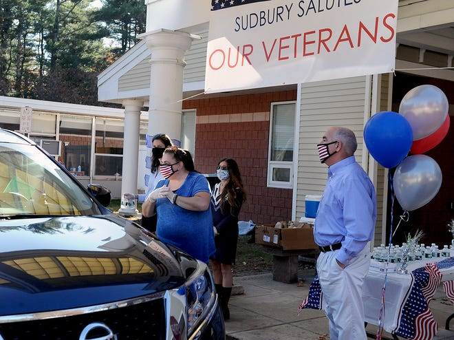 Sudbury Senior Center Administrative Coordinator Chery Finley, center, welcomes one of 67 veterans who participated in a Veterans Appreciation Drive-thru event, Nov. 10, 2020.