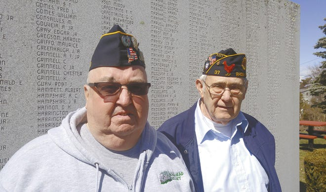 Bertrand Chretien, left, of Little Compton and American Legion Post 37 Commander Bobby Harris of Tiverton stand in front of Tiverton's World War II Honor Roll in 2017. Harris says there is a dwindling number of veterans who want to join veteran service organizations.