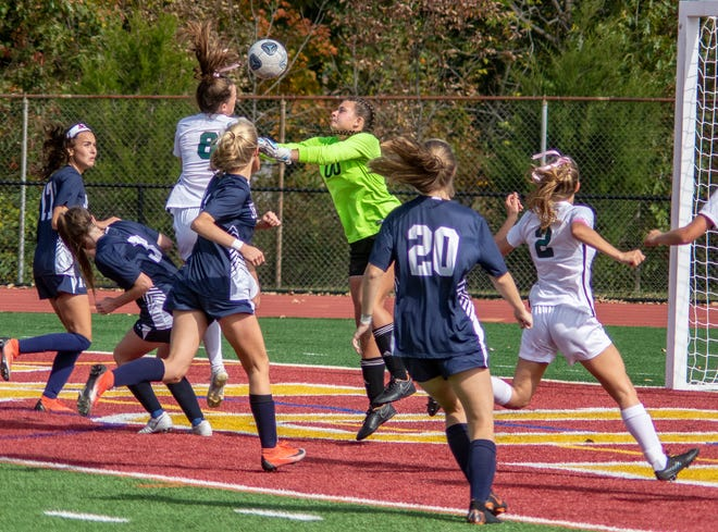 Jefferson goalie Leah Demko, center, makes a save in front of Kinnelon's Kallie Downie (8) in the teams' Morris County Tournament semifinal on Oct. 13, 2019, at Mount Olive High School in Mount Olive.