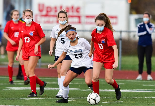 Central Valley Academy players Krista Panko (5) and Isabella Kleban (25) defend against New Hartford's Abby Fletcher (10) during the girls soccer game on Tuesday, Nov. 10, 2020 at Don Edick Field in New Hartford.