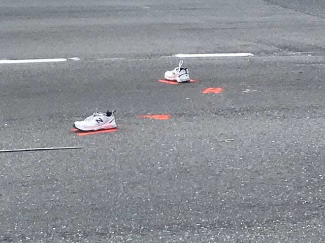 Police marked the spots where a pedestrian's shoes were in the roadway after he was struck by an SUV last Friday. Officers said Michael Stiner of Georgia died at the hospital. The investigation is ongoing.