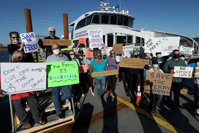 Protesters gather in front of the 2 p.m. ferry in Hingham to voice their displeasure at the proposed cuts to the service on Tuesday, Nov. 10, 2020.