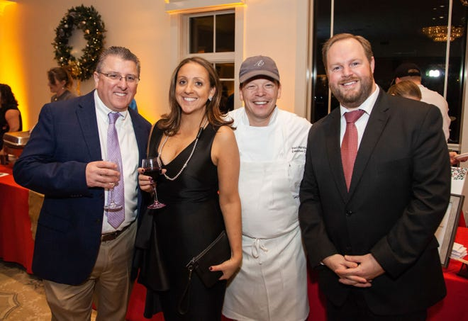 From left, 2019 Feed the Hungry Gala guests Doug McLoud and Cristiana Burke pose with Alma Nove Chef Paul Wahlberg and Interfaith's Executive Director Rick Doane. Wahlberg contributed an auction item and recipe book entry to this year's Feed the Hungry Gala at Home.