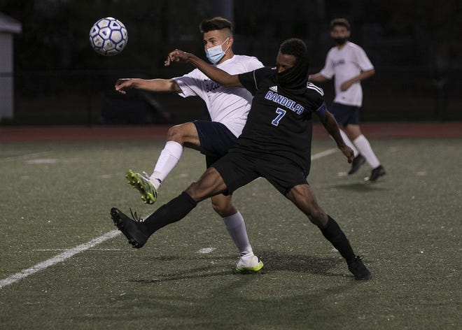 Randolph's Rikendy LaLanne and Rockland's Fernando Cabrera Bamaca vie for possession during the South Shore League Cup second round at Randolph High School on Monday, Nov. 9, 2020.