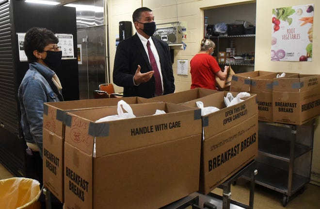The Rochester School Department wants parents to know food is available  to assist students in need as part of its early shift to remote learning, with a heavy focus on the district's meal deliveries and food assistance. From left are Food Service Director Karan Pfingst, Superintendent Kyle Repucci and food worker Brenda Kean.