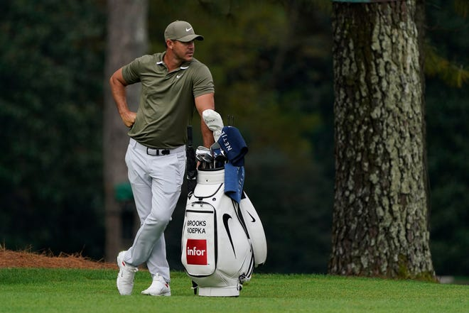 Brooks Koepka waits to hit his second shot the the 17th fairway Tuesday during a practice round for The Masters golf tournament at Augusta National GC. [Michael Madrid-USA TODAY Sports]
